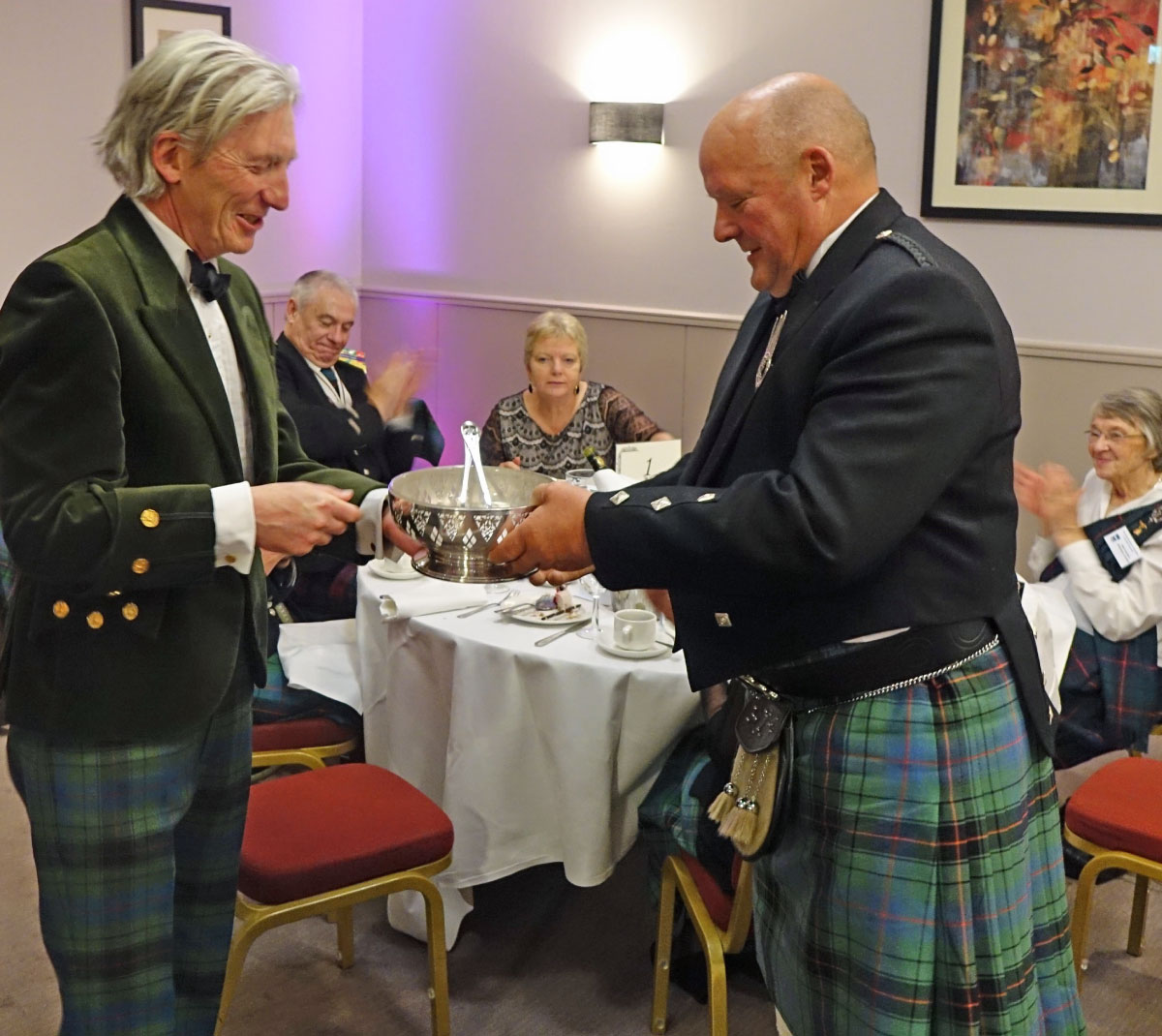 Presentation of gift to Clan Chief (on right)