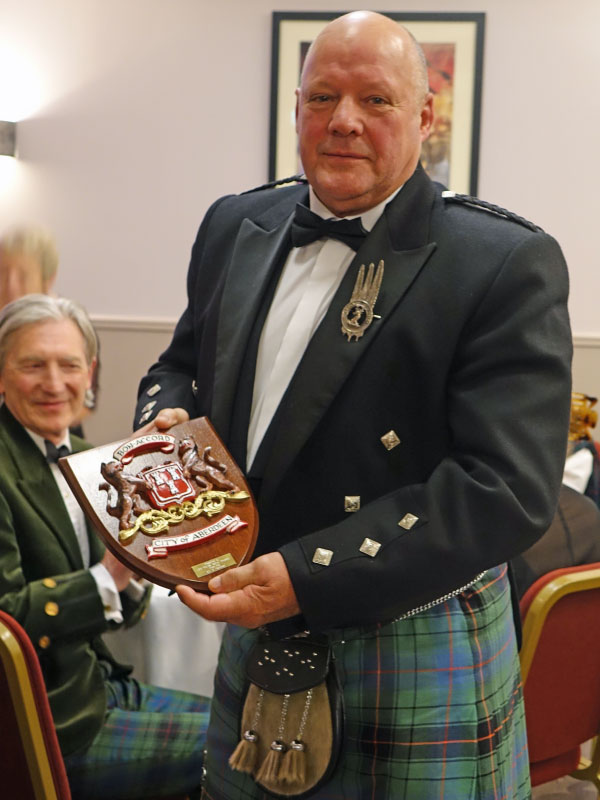 Clan Chief holding gift from Provost of Aberdeen